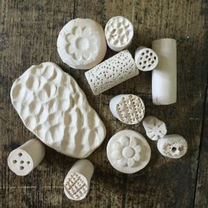 clay stamps made on making together project at birmingham settlement and craftspace