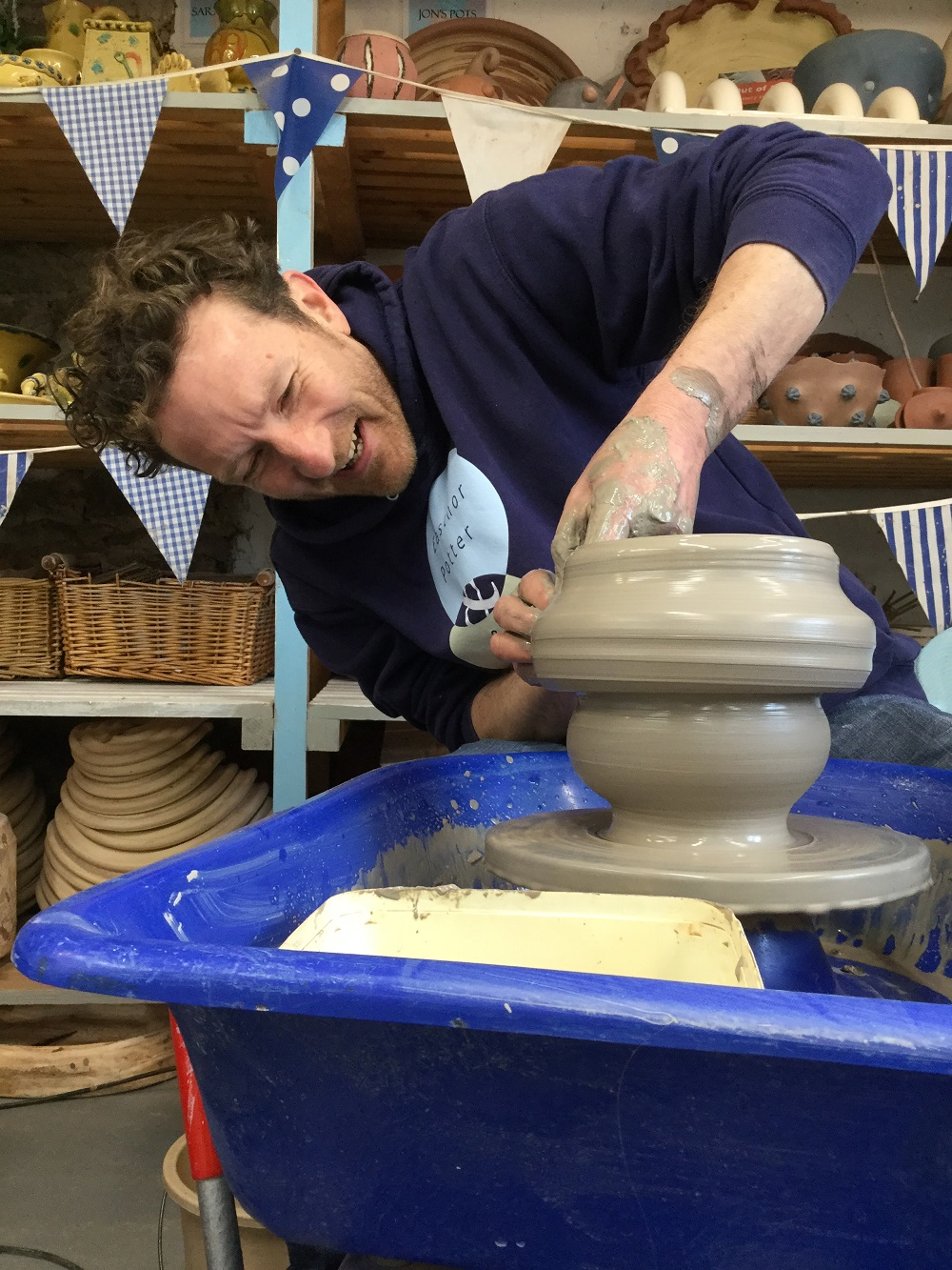 jon williams from eastnor pottery making a pot on the potters wheel