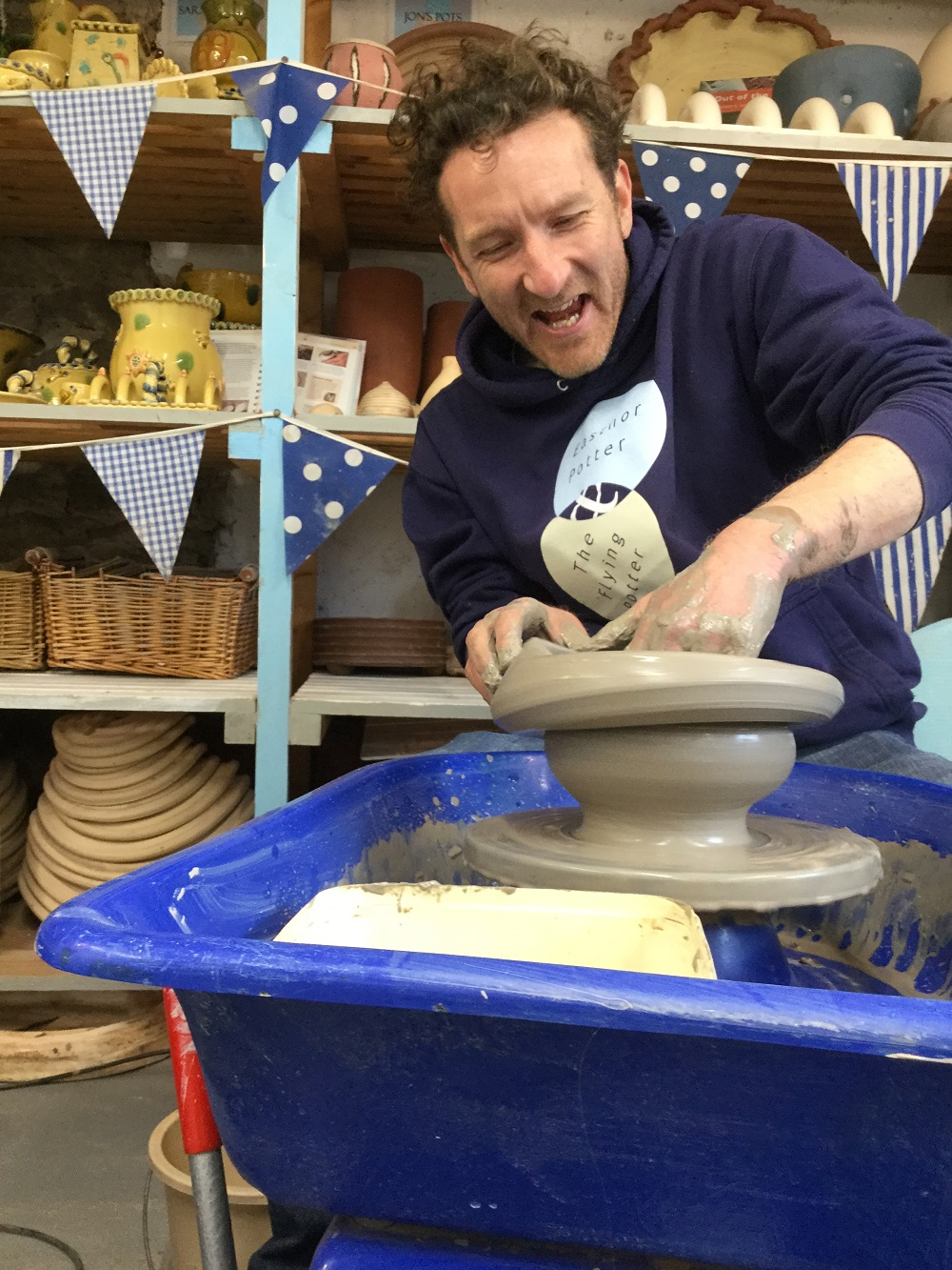 jon the potter making a very wobbly pot on the potter's wheel