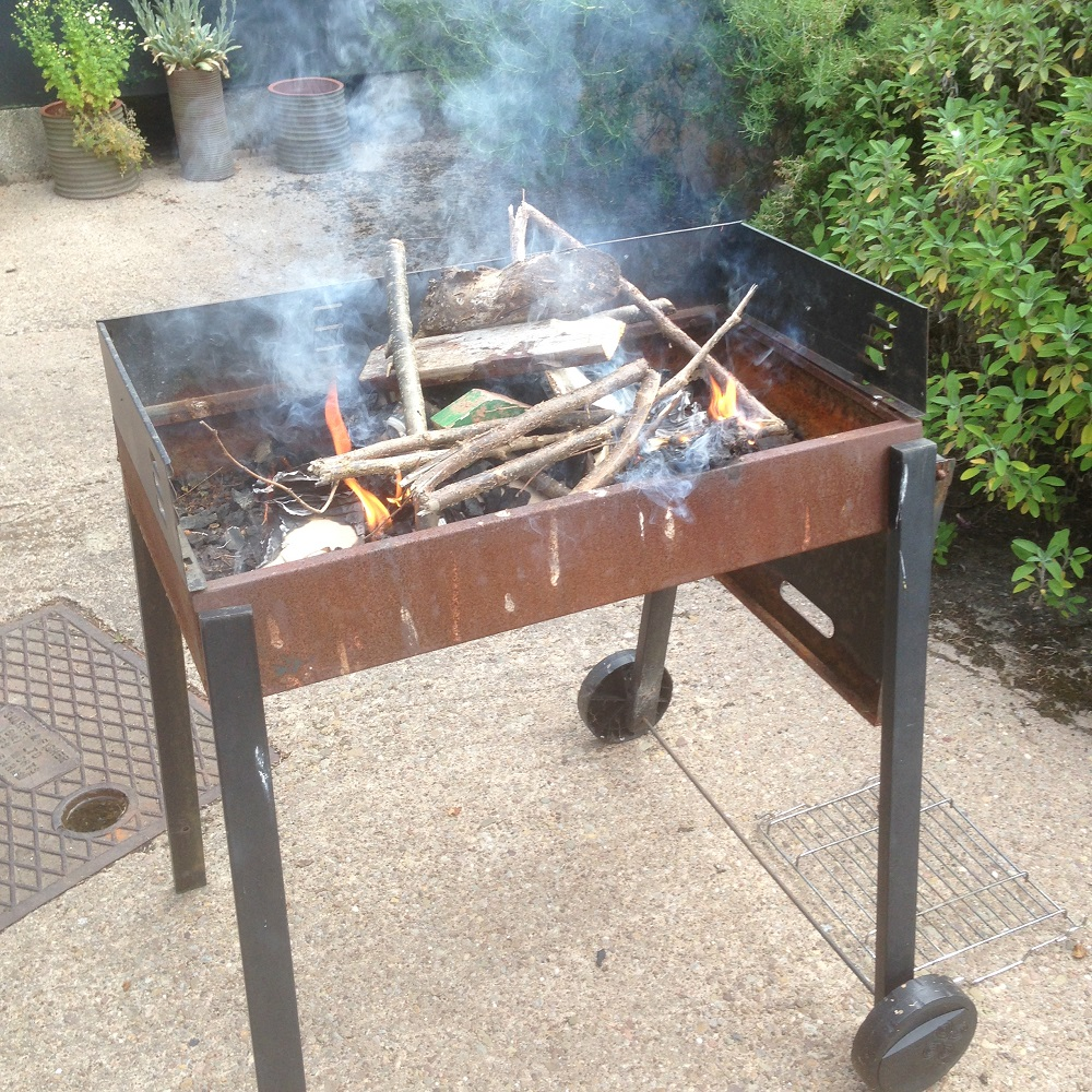 garden bbq filled with ceramic experiments by artist jon williams