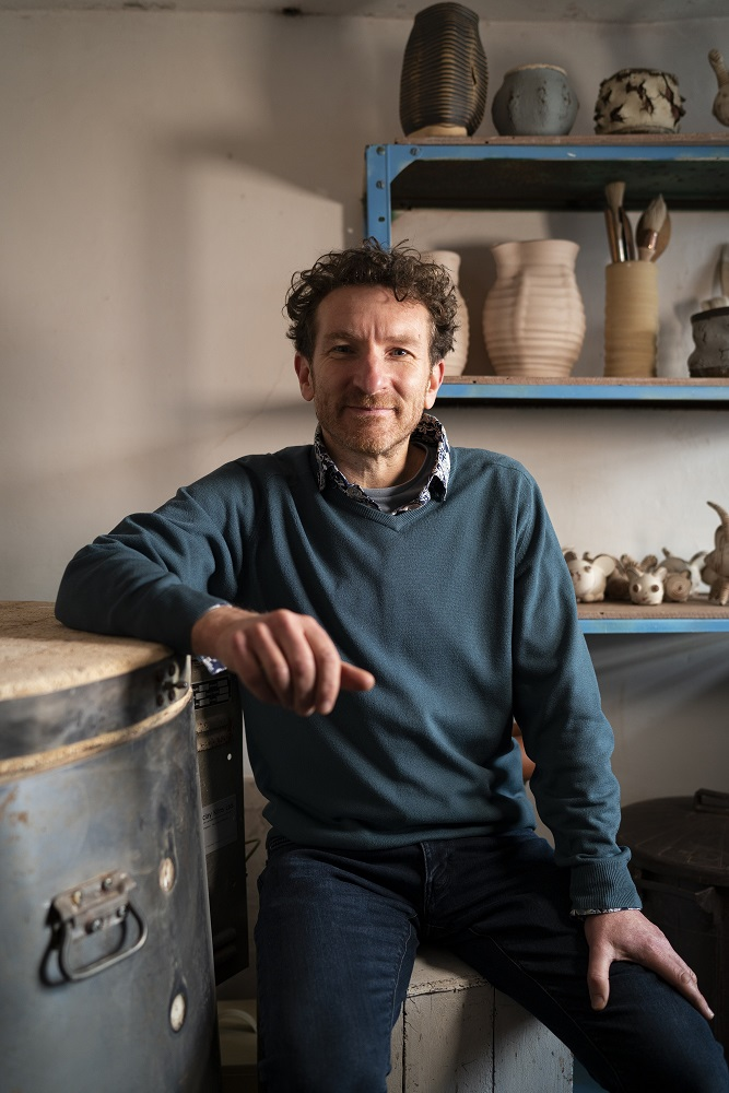 Ceramic artist jon the potter williams in his artist studio in herefordshire