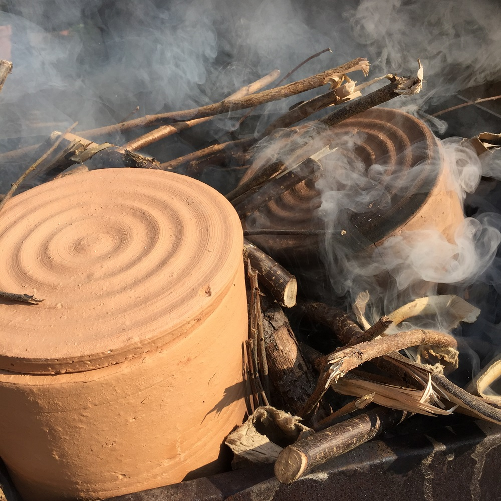 sagger made from brick clay on a fire protecting pottery by herefordshire artist jon williams