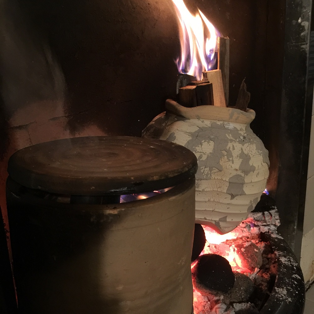 saggers on an open fire place at home with potter jon williams