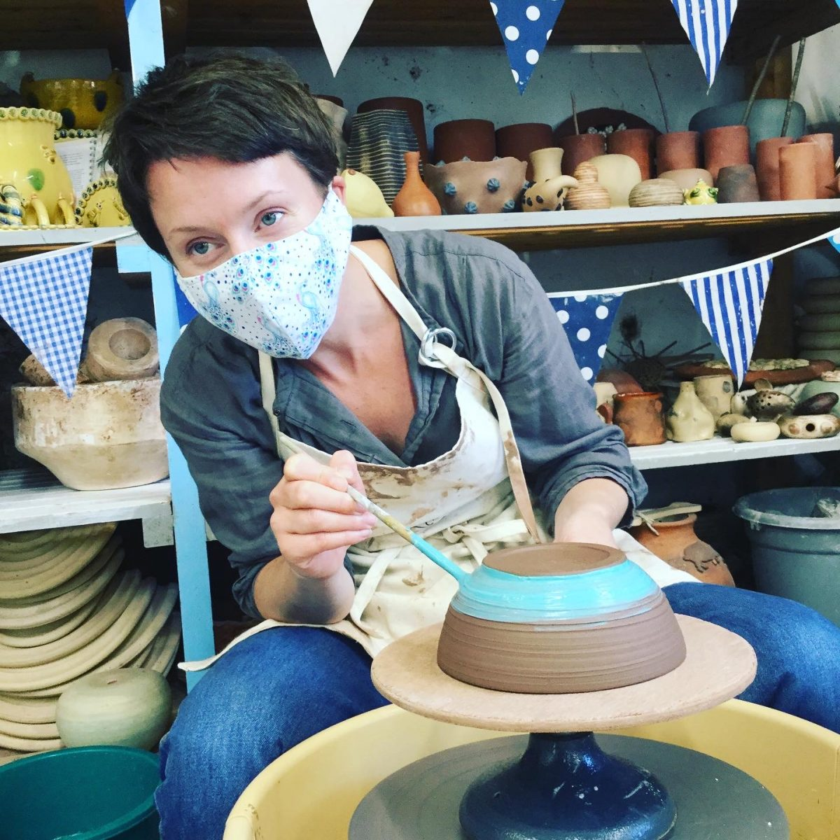 a masked pottery weekend course participant at eastnor pottery