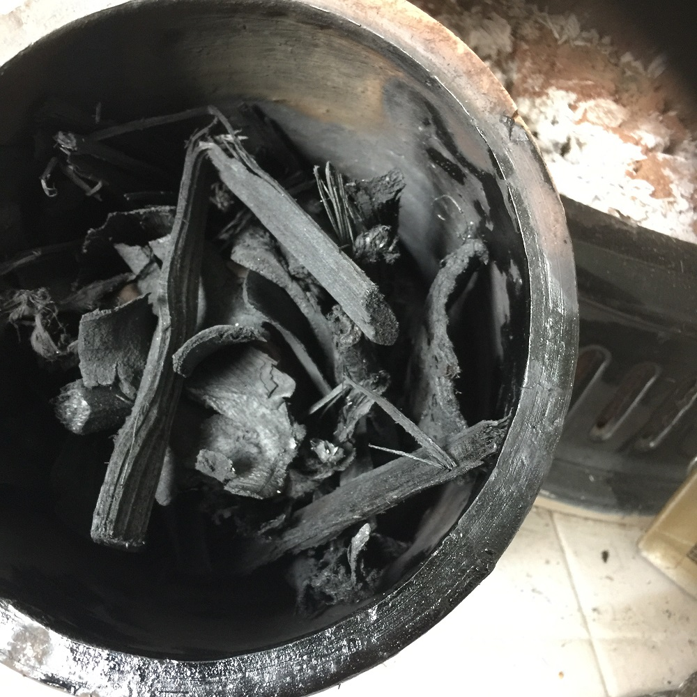 ashes and burnt pottery vessel in a pottery sagger