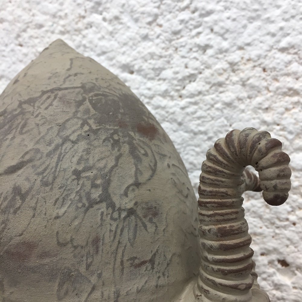 close up of a rocking ceramic snail by jon williams the flying potter