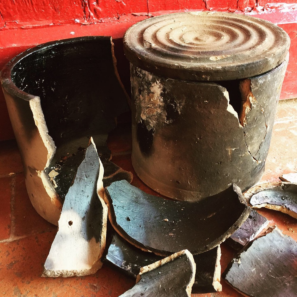 broken saggers used in the fire place by potter jon williams to decorate his pots with smoke